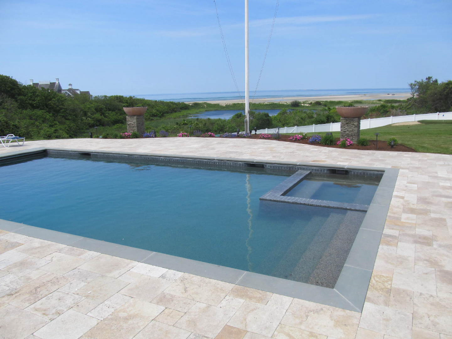 East Dennis Travertine With Bluestone Coping Flaming Urns And Cape Cod Bay